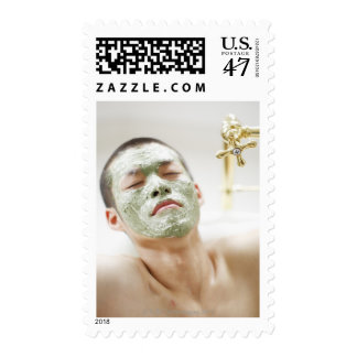 Man Relaxing in a Bathtub with a Facial Mask Postage