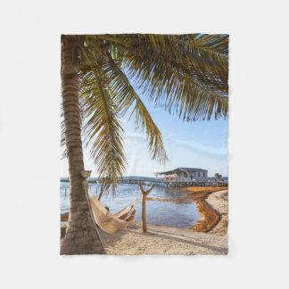 Man Relaxing In A Hammock Under Palm Tree, Belize Fleece Blanket