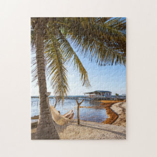 Man Relaxing In A Hammock Under Palm Tree, Belize Jigsaw Puzzle