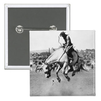 Man riding bucking horse in rodeo 2 inch square button