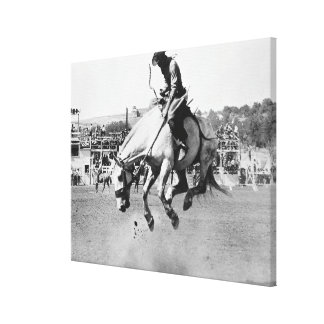 Man riding bucking horse in rodeo canvas print