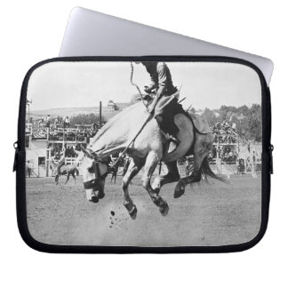 Man riding bucking horse in rodeo computer sleeve