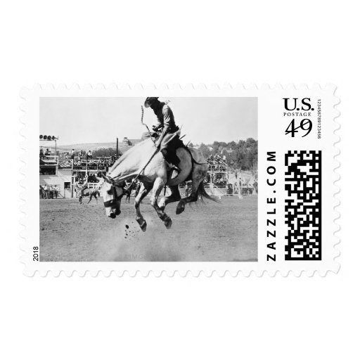 Man riding bucking horse in rodeo postage stamps