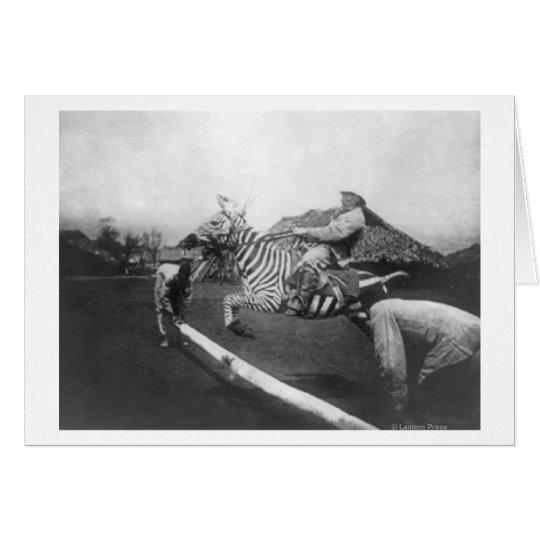 Man Riding Zebra Jumping Fence Photograph Card