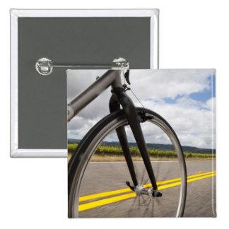 Man road biking at high speed POV Button