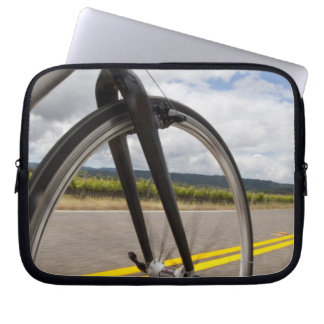 Man road biking at high speed POV Computer Sleeves