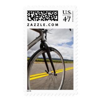 Man road biking at high speed POV Postage Stamp