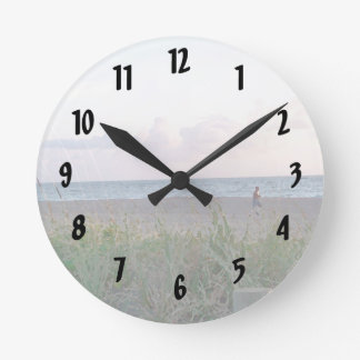 man running on beach painting style image clock