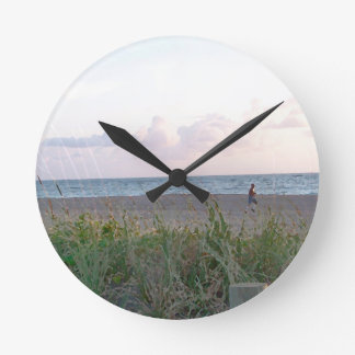 man running on beach painting style image round wall clock
