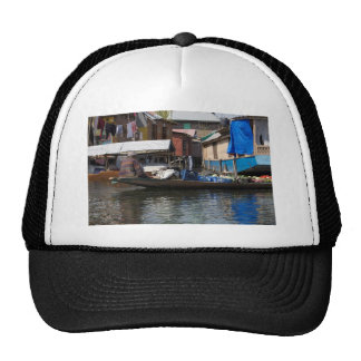 Man selling vegetables from his boat on Dal Lake Hats