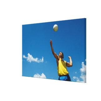 Man serving volleyball canvas print