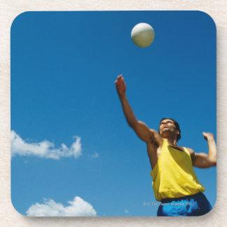 Man serving volleyball beverage coaster