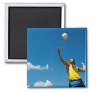 Man serving volleyball magnets