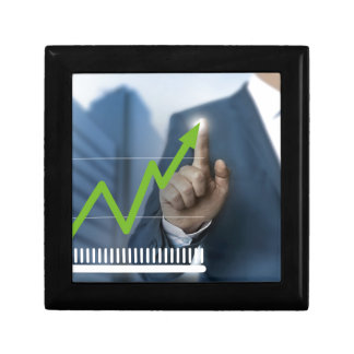 Man showing stock price touchscreen concept jewelry box