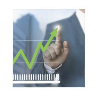 Man showing stock price touchscreen concept note pad