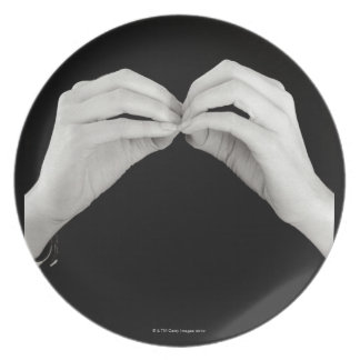Man signing letter b in British sign language, Dinner Plate