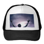 Man silhouette hands stretched up hats