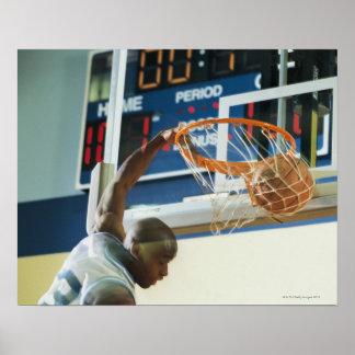 Man slam dunking basketball poster