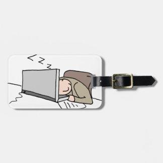 Man sleeping at his computer bag tag
