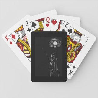 man smoking playing cards