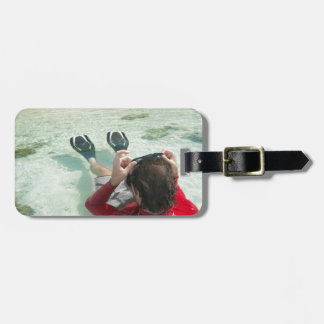 Man snorkeling in shallow water luggage tags