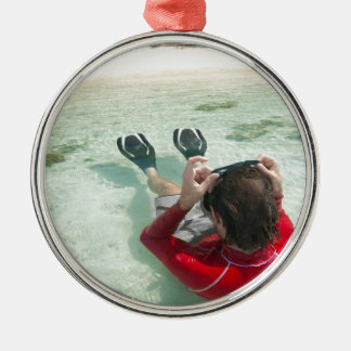Man snorkeling in shallow water metal ornament