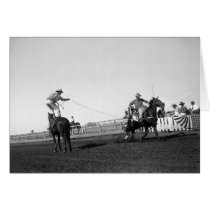 Man standing on a horse roping a horse and rider cards