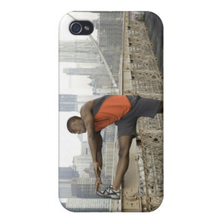 Man stretching on brooklyn bridge iPhone 4 cover
