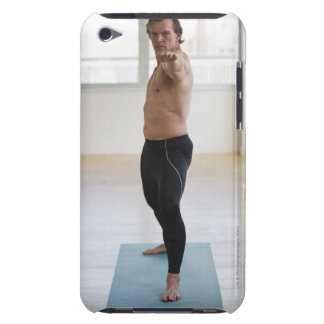 Man stretching on yoga mat iPod Case-Mate cases