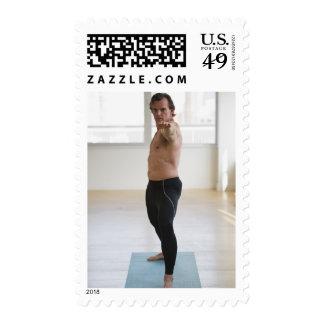 Man stretching on yoga mat stamp