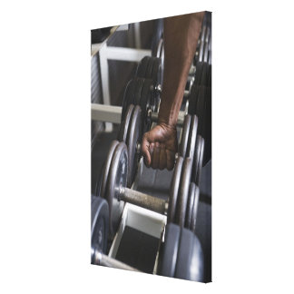 Man taking weight from rack canvas print
