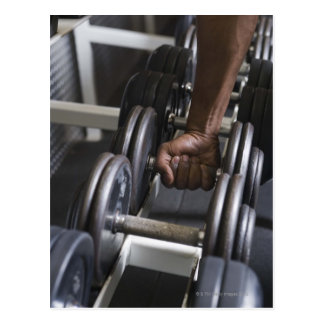 Man taking weight from rack postcard