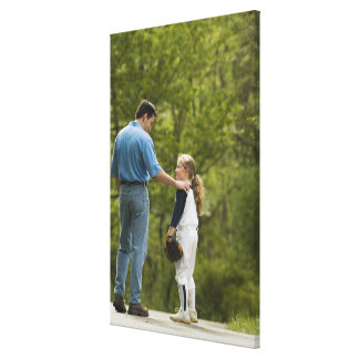 Man talking to girl in baseball uniform canvas print