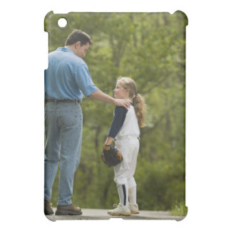 Man talking to girl in baseball uniform case for the iPad mini
