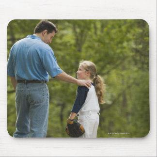 Man talking to girl in baseball uniform mouse pad