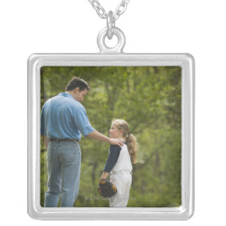 Man talking to girl in baseball uniform pendant