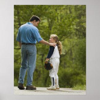 Man talking to girl in baseball uniform poster