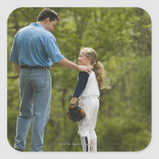 Man talking to girl in baseball uniform square sticker