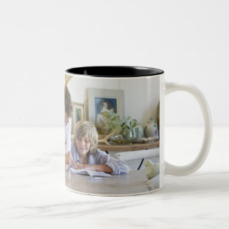 Man talking to little boy with brother using Two-Tone coffee mug