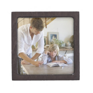 Man teaching his son at house keepsake box
