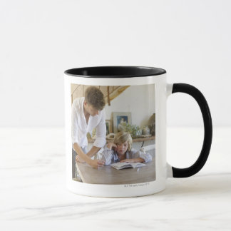 Man teaching his son at house mug