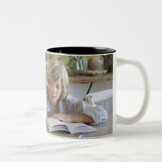 Man teaching his son at house Two-Tone coffee mug