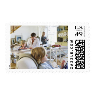 Man teaching little boy while family members postage stamp