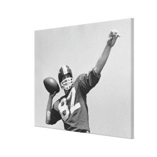 Man throwing football canvas print