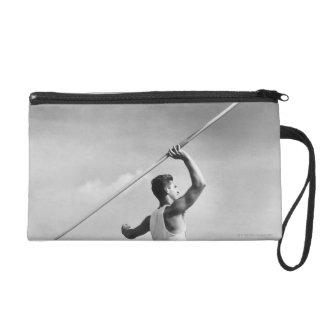Man Throwing Javelin Wristlet Purse