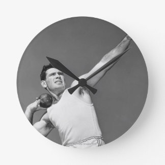 Man Throwing Shotput Round Clock
