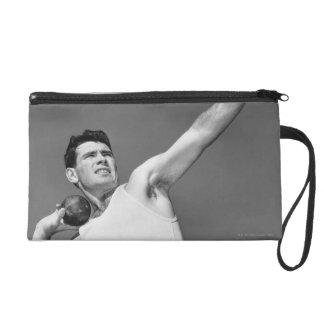Man Throwing Shotput Wristlet Purse