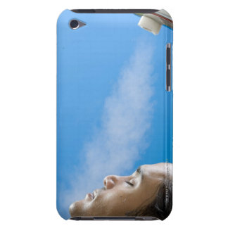Man under steam faucet at spa iPod touch case