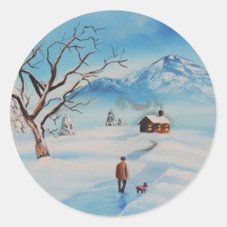 Man walking dog in snow winter mountain scene classic round sticker