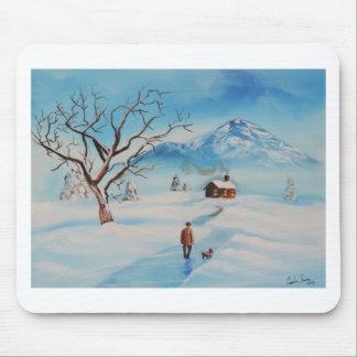 Man walking dog in snow winter mountain scene mouse pad